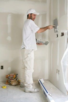 Drywall repair being performed by an experienced Larlin's Home Improvement drywall technician.