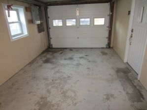 Before Garage Floor Epoxy in Beacon Falls CT by Larlin's Home Improvement
